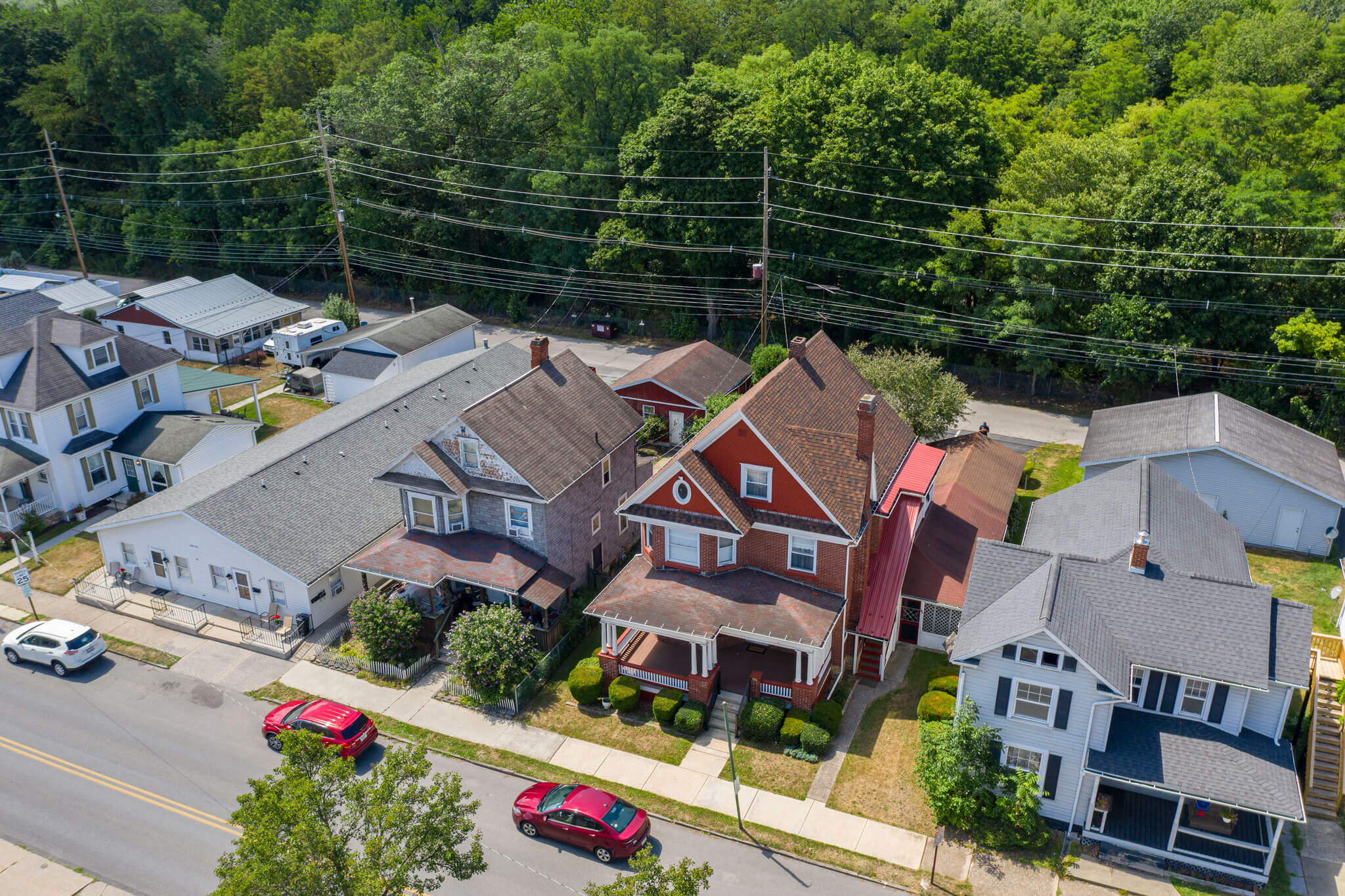 WEBSITE-PHOTO-2---DRONE-RED-CARS-HOUSE