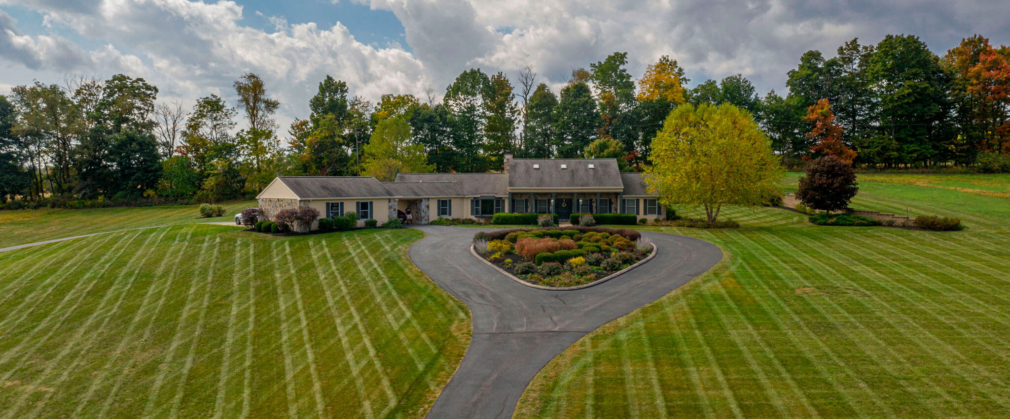 WEBSITE-PHOTO-5-3--MANICURED-LAWN-AND-HOUSE-DRONE-SHOT-1